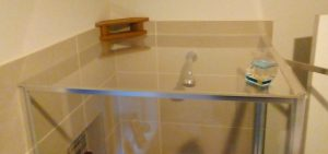 Shower cubicle with perspex resting on top