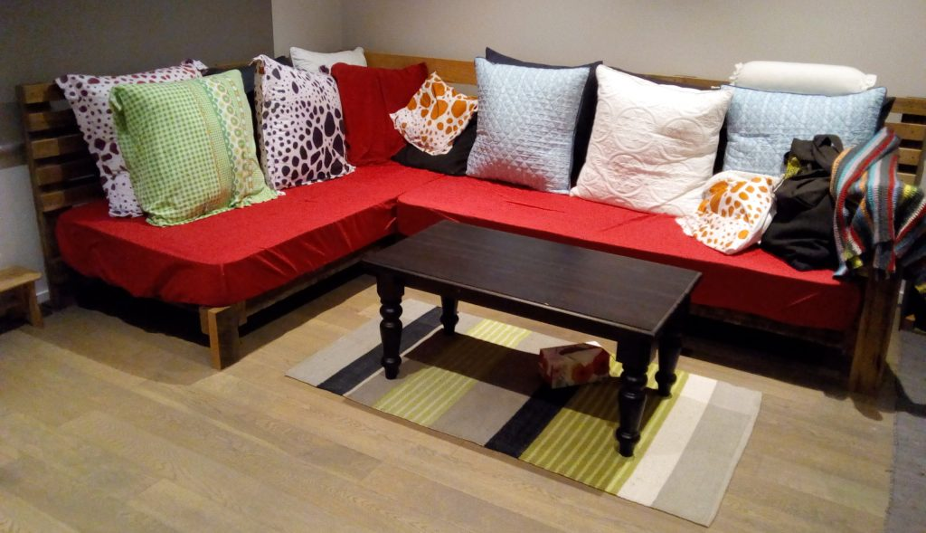 L shaped couch with pillows and coffee table