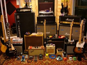 Arrangement of guitars, amplifiers and effects pedals in a room