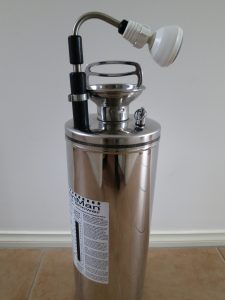 Metal cylinder with telescopic showerhead and pump handle