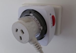 Appliance plugged into electric wall timer