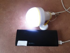USB battery bank with battery powered LED light plugged in