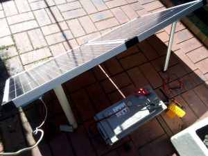 Solar panel and deep cycle battery in courtyard