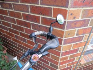Mirror attached to bar end of handlebar